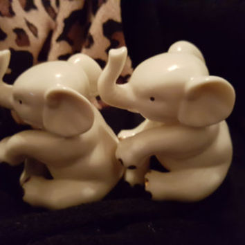 A Set of Two Lenox Porcelain Sitting Baby Elephants in IvoryTone With 24 Kt Gold Accents Free Shipping USA