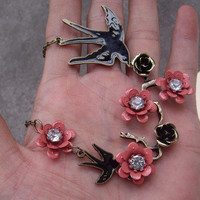 two swallow and flower necklace by qizhouhuang on Etsy