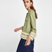 SHORT PARKA WITH TASSELS