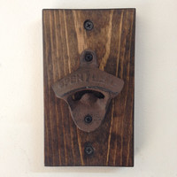 Cast iron bottle opener on wood base, rustic wall mount beer opener