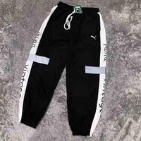 PUMA New fashion women and men side edge marke pants Black