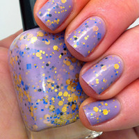 "Nail polish - ""Regal beginnings"" gold, blue and black glitter in a light purple base"