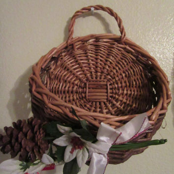 Hanging Natural Wicker Basket - White Poinsettias, Pine Cone, White Bow with Red Glitter Trim