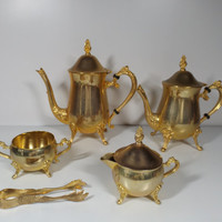Gold plated tea and coffee set ,signed. Home decor. Kitchen decor. Dining.
