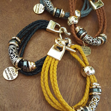 Knitted chunky style bracelets made with cute charms.