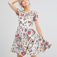 Frock And Frill Petite Floral Embroidered Mini Skater Dress With Cap Sleeves & High Low Hem at asos.com