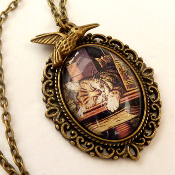 Nostalgic Necklace in bronze with sleeping cat among books