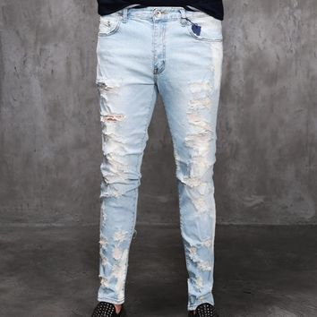 Mens SL Destroyed Light Blue Denim Slim Skinny Jeans at Fabrixquare