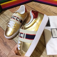 GUCCI Ace gold leather sneaker with Gucci stripe