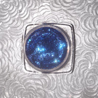 Shade name ( Boheme ). Vibrant blue loose glitter pigment. 4 grams of product in a jar with sifter/seal. Vegan & cruelty free.