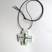 Hand embroidered pendant in green with multicolored Ghanaian glass bead embellishment on cream muslin with a black leather cord summer trend