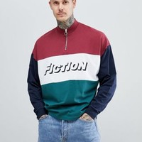 ASOS DESIGN oversized long sleeve t-shirt with text print and zip turtle neck at asos.com