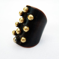 Personal armor. Copper adjustable ring with brass pebbles metalwork