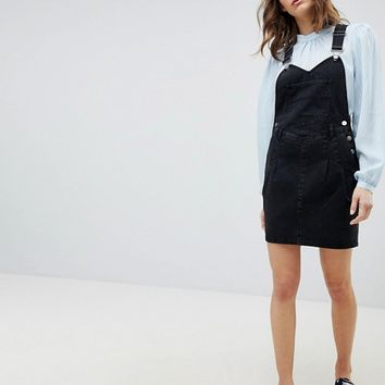ASOS DESIGN denim overall dress in washed black with pleat detail at asos.com