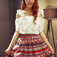 White Embroidered Blouse with Colorful Patterned Skirt