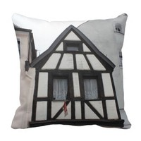 Medieval timbered house throw pillows
