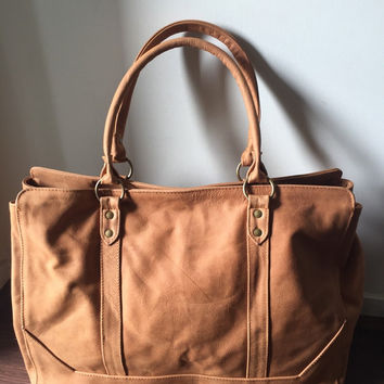 Traditional tan leather tote bag. Computer Work bag.Strong straps, central divider and pocket, traditional tan leather tote bag.Real leather