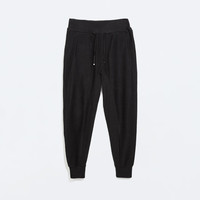 Dark plush trousers