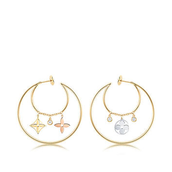 Products by Louis Vuitton: Monogram Idylle Dangling Variations earrings, 3 golds and diamonds