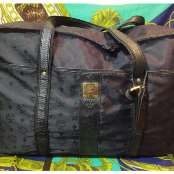 Vintage MCM black monogram large travel bag with leather trimmings. Unisex use as classic style in originality. Phenomenon