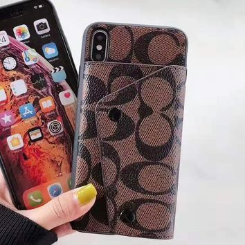 Coach selling fashionable printed button clamshell cases for men and women