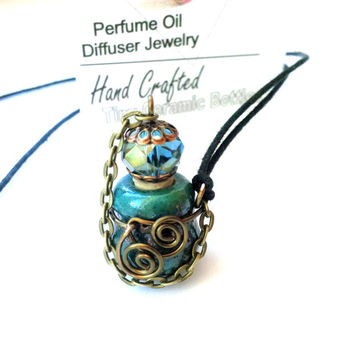 Essential Oils Aromatherapy Necklace Tiny Perfume Bottle Diffuser Vessel Necklace in Blue on Long Adjustable Cord