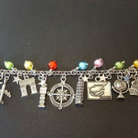 Around the world themed stainless steel charm bracelet