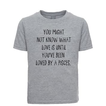 You might not know what love is until you've been loved by a Pisces. Unisex Kid's Tee