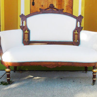 Restored Antique Settee Bench with Rich Cream Upholstery and Gold Accents