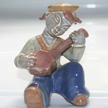 Music Man  Blue and Brown Figurine