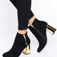 New Look Suedette Heeled Ankle Boot with Metal Block Heel. at asos.com