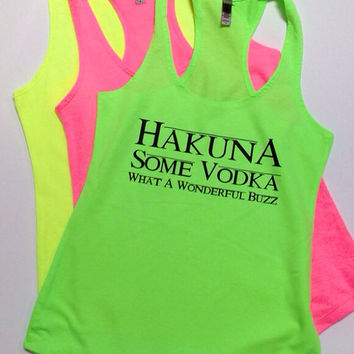 Hakuna Some Vodka with Lion King font on Neon Pink, Yellow, and Green Terry Racerback Tanks. Fun tanks for the pool or beach!