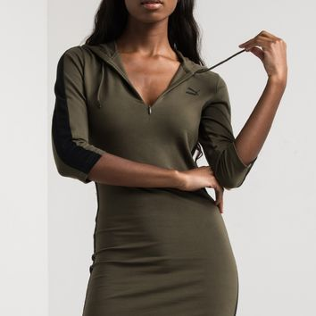 PUMA Zip Up Hooded Back Hem Logo Long Sleeve Mini Dress in Olive Night