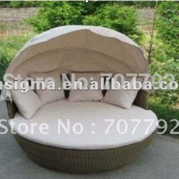 Wicker outdoor sun bed with canopy