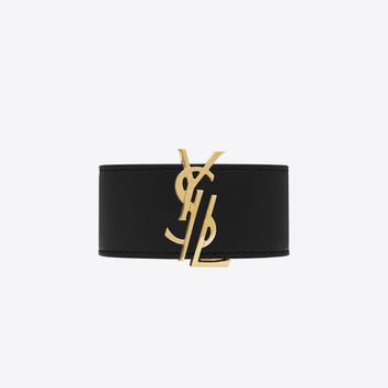 de force bracelet in gold metal and black leather