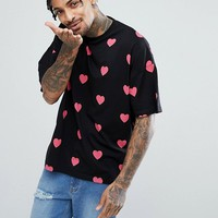 ASOS Valentines Oversized T-Shirt With All Over Heart Print at asos.com
