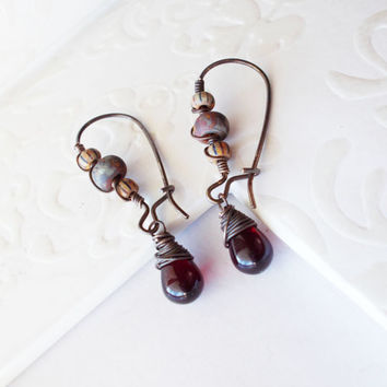 Primitive garnet dangle earrings, old world striped beads, wire wrapped brass kidney hooks, czech glass drops