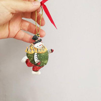 Snowman Christmas ornament, tin Xmas tree ornament of snowman in green red clothes, smiling snowman ornament, boho rustic Xmas decor