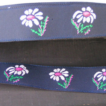 White daisy with bright pink center on a navy blue taffeta like background Jacquard ribbon. Truly beautiful summer ribbon trimming.