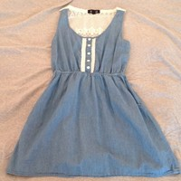 Adorable denim dress with lace back & pockets.