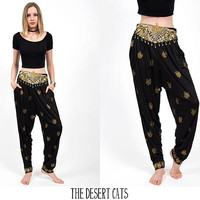 vintage 1980s high waisted pants black and metallic gold feather printed pants vintage boho gypsy beaded festival pants