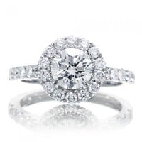 Diamond solitaire round halo engagement ring pavé setting