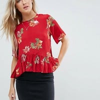 ASOS Tee with Asymmetric Ruffle Hem in Red Floral at asos.com
