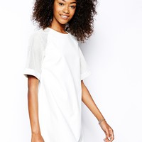 Motel PU Baseball Dress With Perforated Sleeves - Pu cream