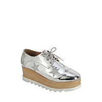 Ladies fashion lace up oxford, closed almond toe, tractor wedge flatform, lace up closure, with decorative star details.