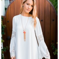 Falicity - White shift dress with bell sleeves and lace trim details. Also available in yellow.