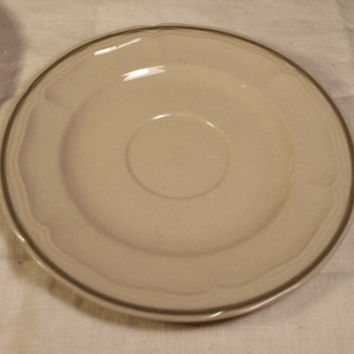 Newcor Stoneware New Port Saucer Set of 4 Made in Japan Dark Cream Color with Grey Stripe and embossed edging by Newcor Saucers