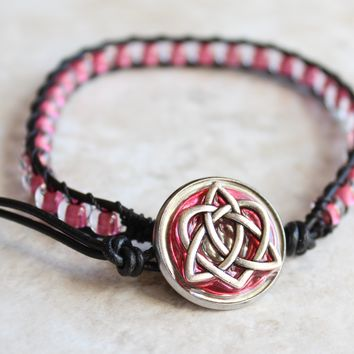 Celtic sister knot bracelet in pink / with black thread