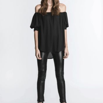 Travel far and wide in style with this Insatiable Wanderer Off Shoulder Top by Blaque Label! This smemi-sheer sexy flowy chiffon top features elasticized off-the-shoulder neckline, short sleeves with cuffs and 3 button closure, and finished with asymmetric