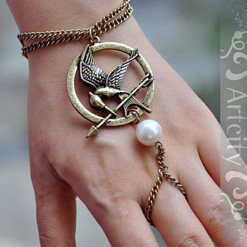 The Hunger Games  Mockingjay pendant Arrow and Peeta pearl bracelet and ring -- Brass